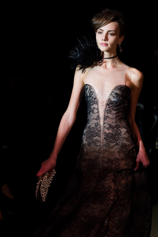 """. A model walks the runway during Giorgio Armani\'s \""""One Night Only New York� fashion show on Thursday, Oct. 24, 2013 in New York. (Photo by Charles Sykes/Invision/AP)"""