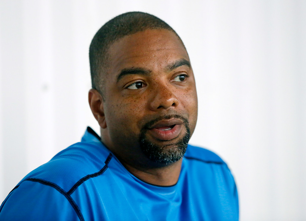 . iDetroit Lions Senior Director of Player Development Galen Duncan talks with a reporter during the final day of minicamp Thursday, June 12, 2014, in Detroit. (AP Photo/Duane Burleson)