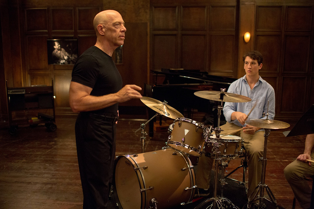 """. This image released by Sony Pictures Classics shows J.K. Simmons , left, and Miles Teller in a scene from \""""Whiplash.\"""" Simmons was nominated for a Golden Globe for best supporting actor for his role in the film on Thursday, Dec. 11, 2014. The 72nd annual Golden Globe awards will air on NBC on Sunday, Jan. 11. (AP Photo/Sony Pictures Classics, Daniel McFadden)"""