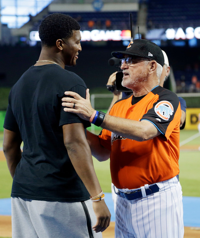 . Tampa Bay Bucs quarterback Jameis Winston, left, talks to National League manager Joe Maddon, of the Chicago Cubs, prior to the the MLB All-Star game, Tuesday, July 11, 2017, in Miami. (AP Photo/Lynne Sladky)