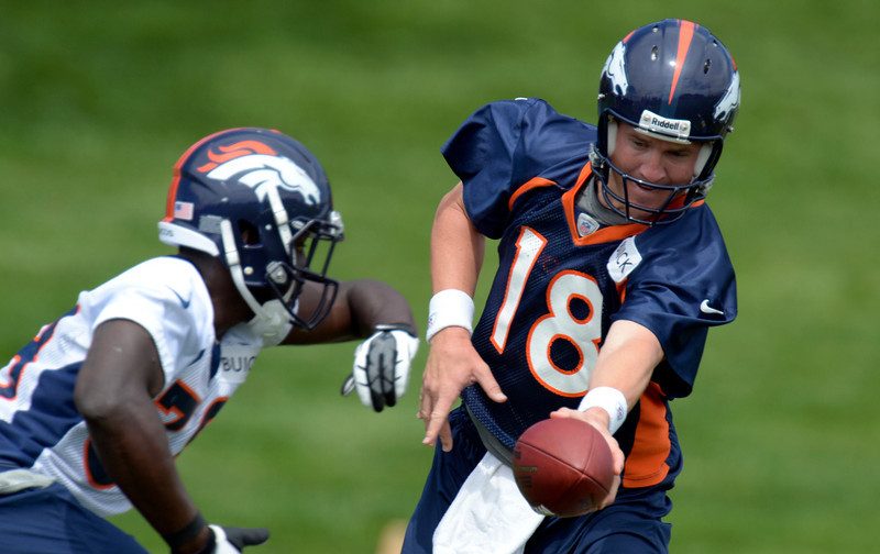 . Peyton Manning (18) of the Denver Broncos hands off to Montee Ball (38) during drills at mini camp June 12, 2013 at Dove Valley. (Photo By John Leyba/The Denver Post)