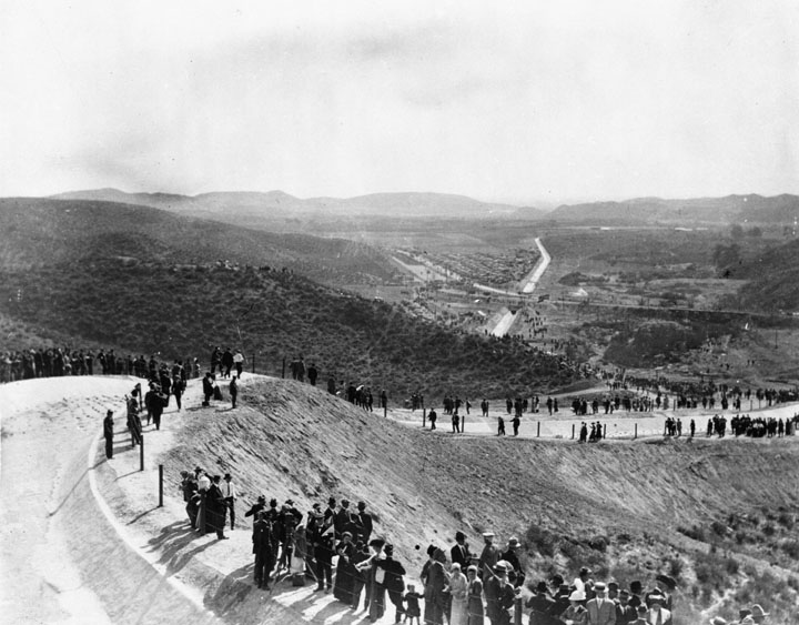 . (November 5, 1913) - Crowds start gathering early for the LA Aqueduct opening day celebration. By noon, 25,000 persons had stationed themselves around the natural amphitheater that centered at the concrete canal called the �Cascades.�  (DWP)