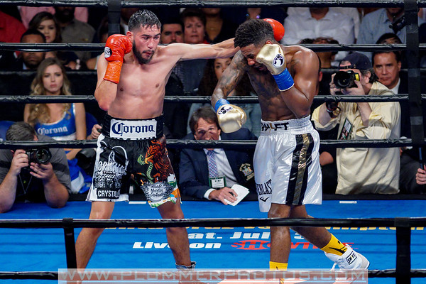 Jarrett Hurd Defeats Oscar Molina by 10th Round TKO