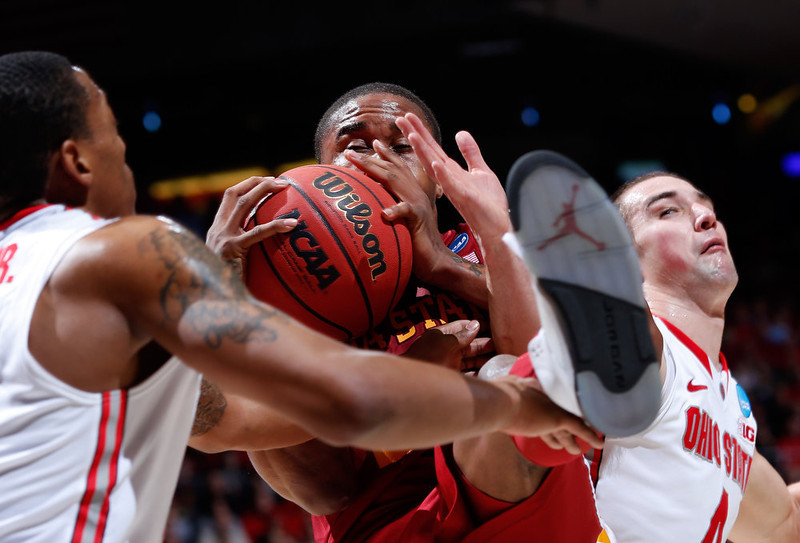 . Melvin Ejim #3 of the Iowa State Cyclones fights for the ball with Lenzelle Smith, Jr. #32 and Aaron Craft #4 of the Ohio State Buckeyes in the second half during the third round of the 2013 NCAA Men\'s Basketball Tournament at UD Arena on March 24, 2013 in Dayton, Ohio.  (Photo by Joe Robbins/Getty Images)