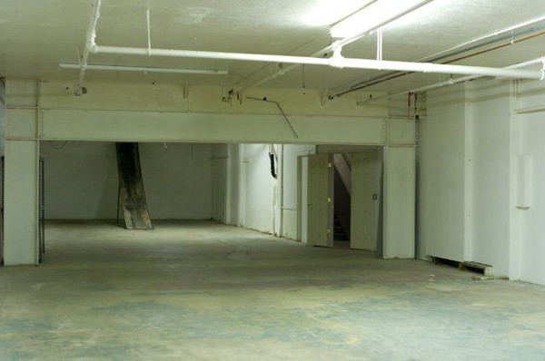 back of the basement,slide from upper level, probably remove that.  door to stairs on the right.