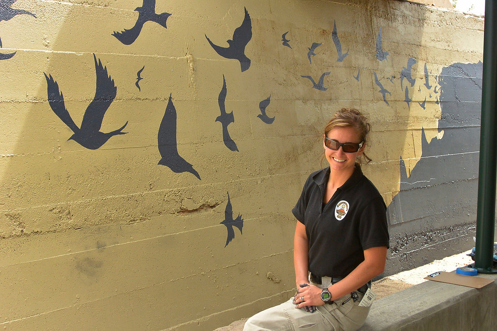 . Castle Rock police officer Renee Tremaine shows off her artwork after she finished one side of the underpass at Hangmans Gulch  June 10, 2014 along the Plum Creek trail.  (Photo by John Leyba/The Denver Post)