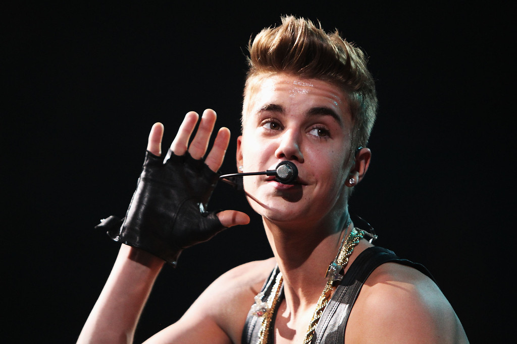 . WASHINGTON, DC - DECEMBER 11:  Musician Justin Bieber performs onstage during Hot 99.5\'s Jingle Ball 2012, presented by Charleston Alexander Diamond Importers, at The Patriot Center on December 11, 2012 in Washington, D.C.  (Photo by Paul Morigi/Getty Images for Jingle Ball 2012)