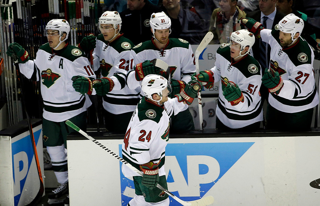 . Minnesota Wild\'s Matt Cooke (24) celebrates his goal with teammates during the first period of an NHL hockey game against the San Jose Sharks on Saturday, Jan. 25, 2014, in San Jose, Calif. (AP Photo/Marcio Jose Sanchez)