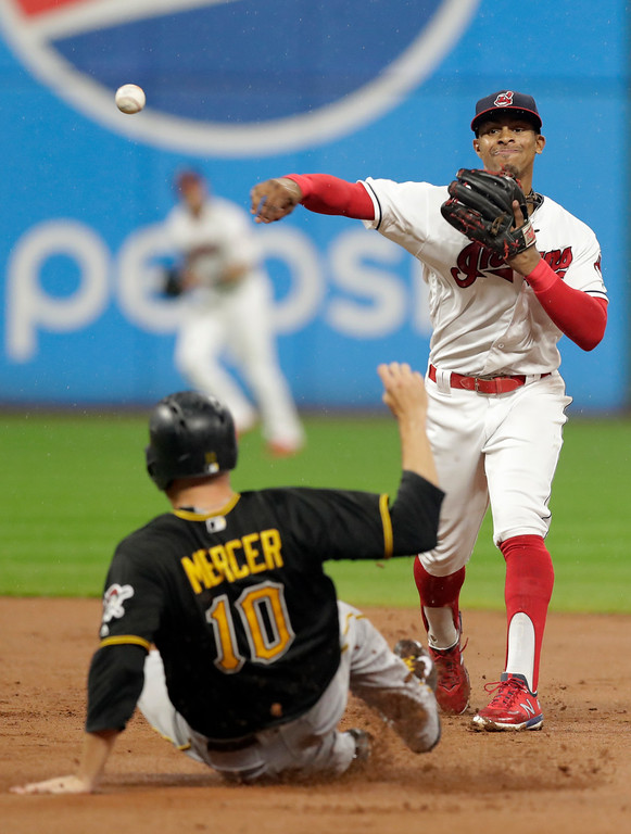 . Cleveland Indians\' Francisco Lindor gets Pittsburgh Pirates\' Jordy Mercer at second base in the fourth inning of a baseball game, Monday, July 23, 2018, in Cleveland. Corey Dickerson was safe at first base. (AP Photo/Tony Dejak)