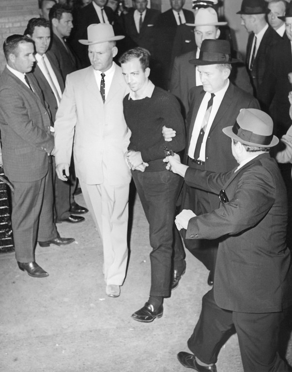. Jack Ruby approaches and fires on  Lee Harvey Oswald as Oswald is escorted to the Dallas jail via the underground garage on Nov. 24, 1963. Oswald was  escorted by Detectives Jim Leavelle, left, who is handcuffed to Oswald, and L.C. Graves. Oswald later died at a hospital. Jack Beers, Dallas Morning News