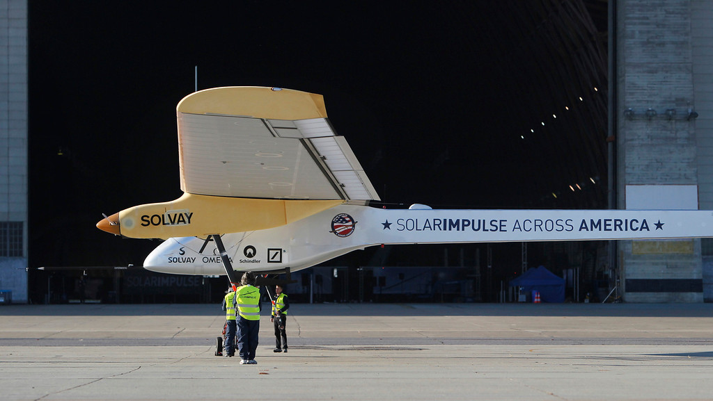 . The ground crew moves the Solar Impulse, the experimental airplane, into a hangar after it made a test flight at Moffett Airfield in Mountain View, Calif. Friday morning April 19, 2013.  (Patrick Tehan/Staff)