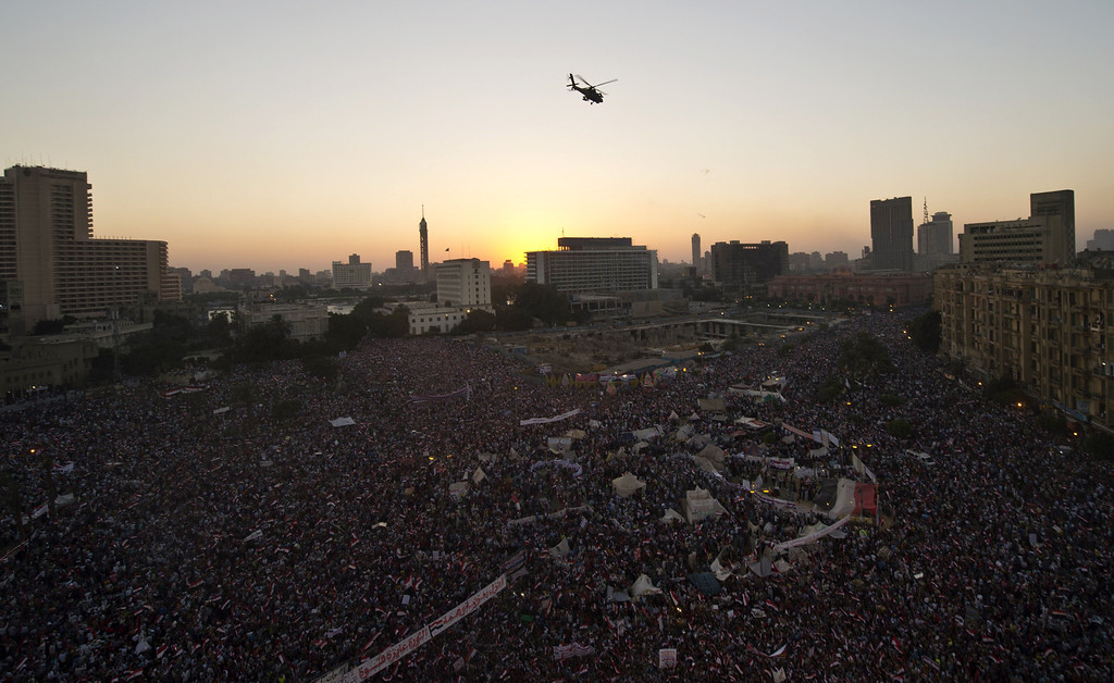 ". A picture taken on July 26, 2013 shows an helicopter flying above crowded Tahrir Square in Cairo during a rallye of opponents to deposed Egyptian president Mohamed Morsi. At Tahrir Square, tens of thousands of anti-Morsi supporters gathered in response to a call by the army chief General Abdel Fattah al-Sisi on Egyptians to show their support for a security clampdown on ""terrorism\"".  KHALED DESOUKI/AFP/Getty Images"