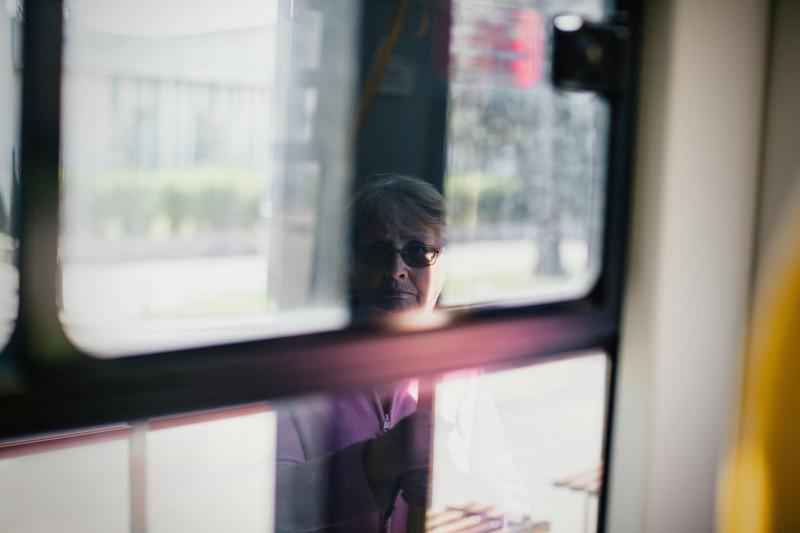 reflection of lady in tram window.jpg
