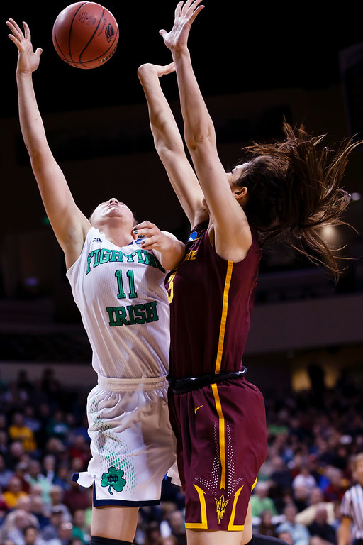 . Notre Dame forward Natalie Achonwa (11) shoots on Arizona State center Joy Burke (3) during the second half in a second-round game in the NCAA women\'s college basketball tournament in Toledo, Ohio, Monday, March 24, 2014. (AP Photo/Rick Osentoski)