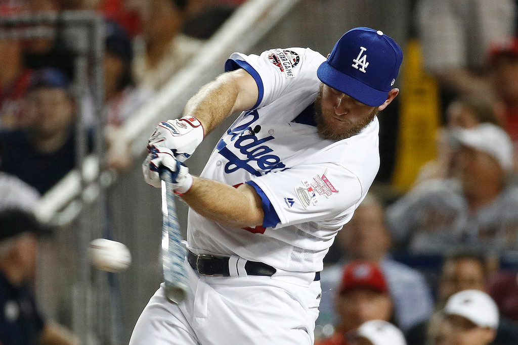 . Los Angeles Dodgers Max Muncy (13) hits during the MLB Home Run Derby, at Nationals Park, Monday, July 16, 2018 in Washington. The 89th MLB baseball All-Star Game will be played Tuesday. (AP Photo/Patrick Semansky)