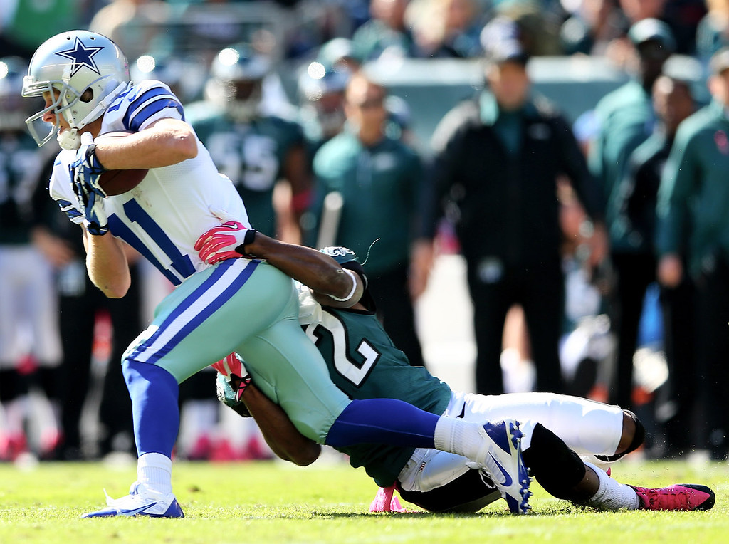 . Cole Beasley #11 of the Dallas Cowboys is tackled by Brandon Boykin #22 of the Philadelphia Eagles in the first quarter on October 20, 2013 at Lincoln Financial Field in Philadelphia, Pennslyvania.  (Photo by Elsa/Getty Images)
