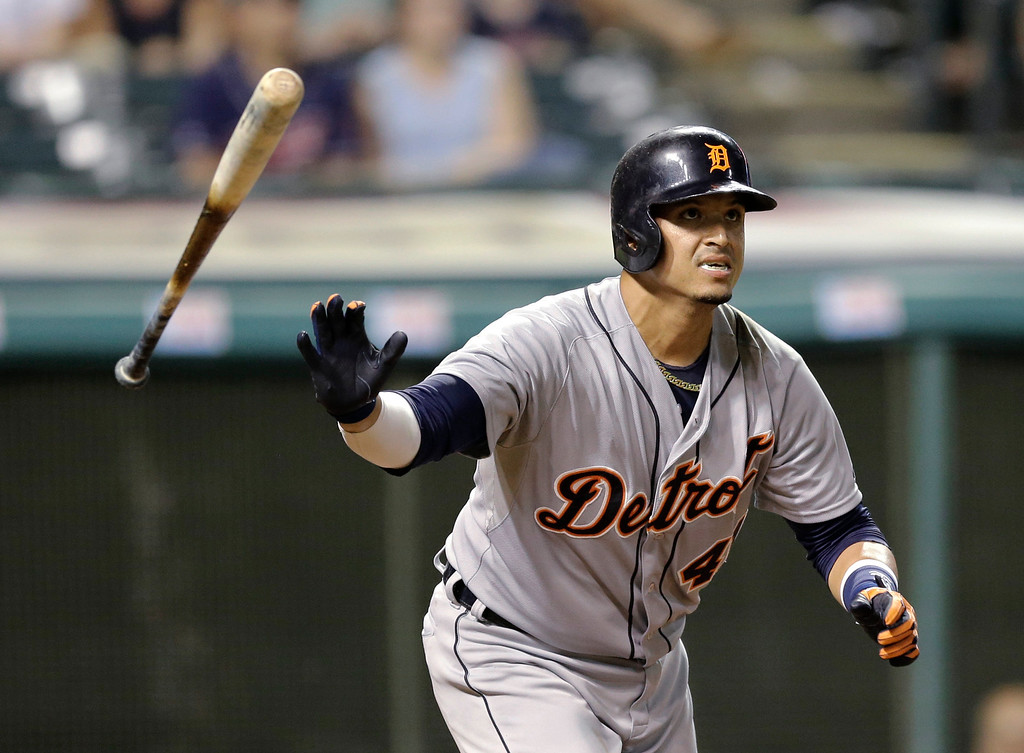 . Detroit Tigers\' Victor Martinez watches his three-run home run off Cleveland Indians relief pitcher Josh Tomlin in the 11th inning of a baseball game, Thursday, Sept. 4, 2014, in Cleveland. (AP Photo/Tony Dejak)