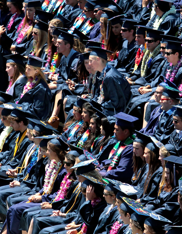 . The Aptos High class of 2013 listens to the welcome by the school\'s principal Casey O\'Brien as commencement exercises get under way Thursday. (Shmuel Thaler/Sentinel)