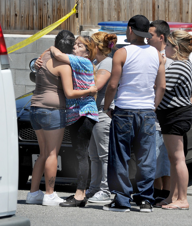 . Angelika Rangel, left, who is pregnant, and her boyfriend was found shot to death on Weaver Avenue, receives a warm embrace from her mother Shirley Beserra.  Los Angeles County Sheriff\'s officials investigate a shooting at a business where a man is found dead 10700 block of Weaver Avenue in South El Monte on Tuesday, June 18, 2013. (SGVN/Staff photo by Walt Mancini)