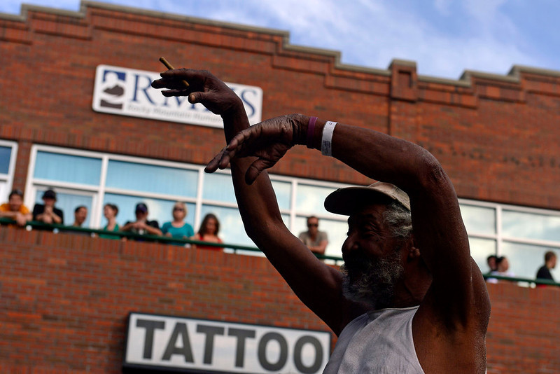 . Stanley Lee Moore, 64, dances as the Buckner Funken Jazz band performs on the Five Points Plaza stage at the Five Points Jazz Festival, May 18, 2013. The festival runs 11am to 8pm on May 18, 2013 and is a free community event highlighting local musicians, art and the historic Denver Five Points neighborhood.  (Photo By Mahala Gaylord/The Denver Post)