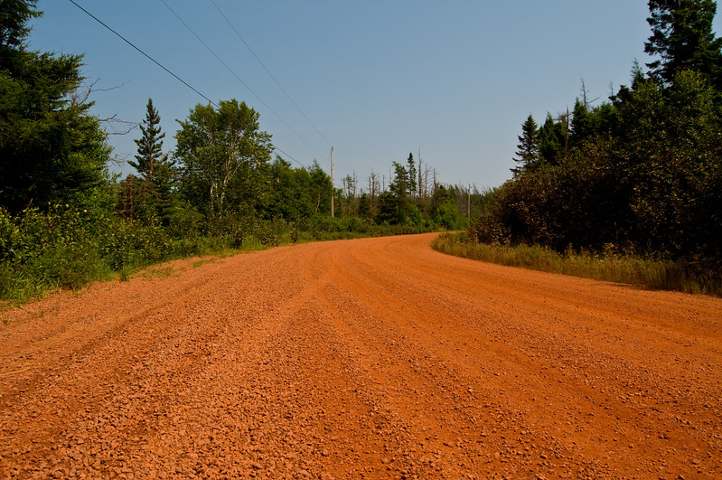 This is the gravel road we started down... looks well graded and maintained (plus, it gives PEI a run for its money with regard to redness) .... little did we know that we'd end up on a rutted, barely passable donkey track!