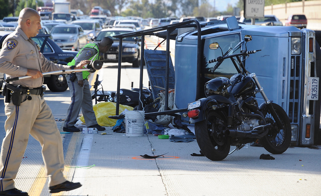 . Los Angeles CA. July 17,2013. CHP at the scene were a motorcycle rider was killed after a crash involving a pickup truck that rolled on it\'s side on the south bound 405 freeway between Victory and Burbank BL. The crash happen in the carpool lane at around 4:15 pm and one other person was taken to the hospital. Photo by Gene Blevins/LA Daily News