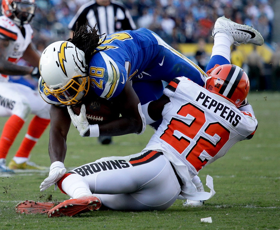 . Los Angeles Chargers running back Melvin Gordon, top, is tackled by Cleveland Browns free safety Jabrill Peppers during the second half of an NFL football game Sunday, Dec. 3, 2017, in Carson, Calif. (AP Photo/Jae C. Hong)