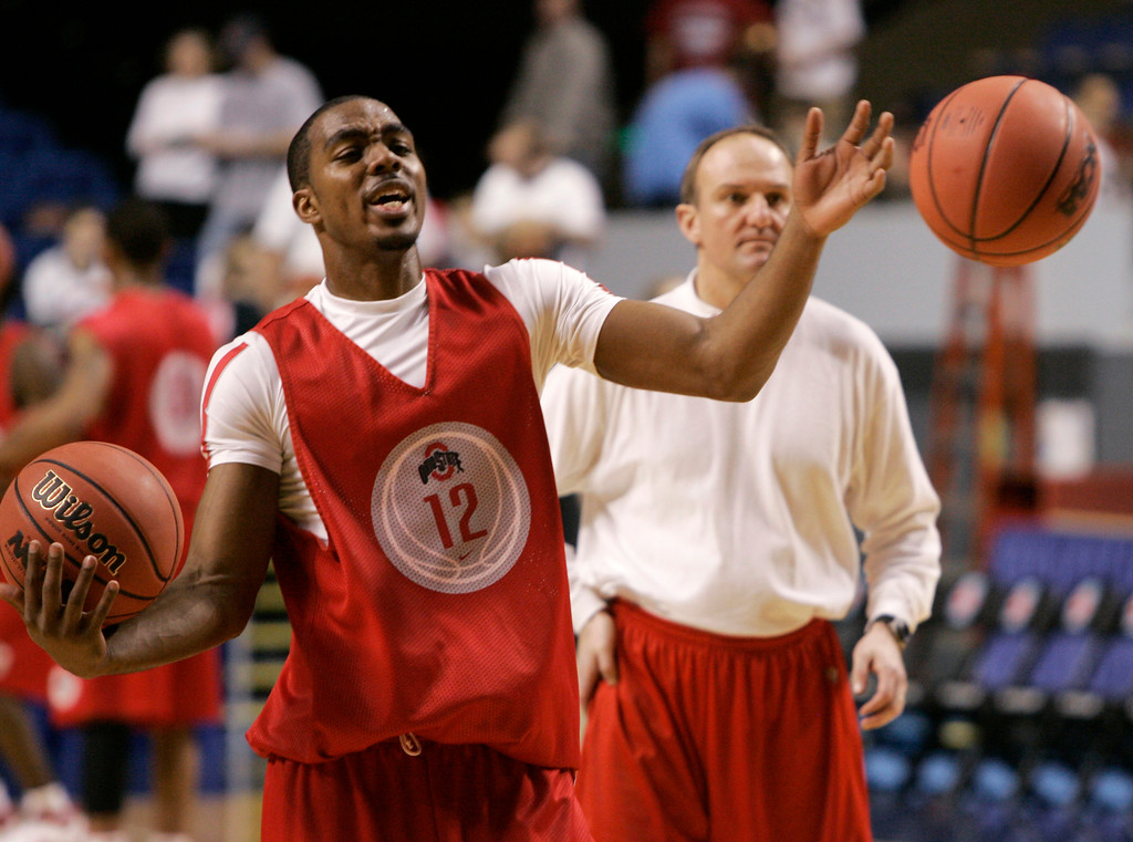 . Ohio State guard Ron Lewis, left, reacts as balls are thrown at him as the team practiced in Lexington, Ky., Wednesday, March 14, 2007. Ohio State will face Central Connecticut State on Thursday in the first round of the NCAA men\'s basketball tournament. (AP Photo/Al Behrman)