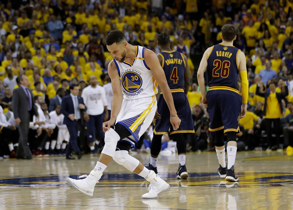 . Golden State Warriors guard Stephen Curry (30) reacts after scoring against the Cleveland Cavaliers during the second half of Game 1 of basketball\'s NBA Finals in Oakland, Calif., Thursday, June 1, 2017. (AP Photo/Marcio Jose Sanchez)