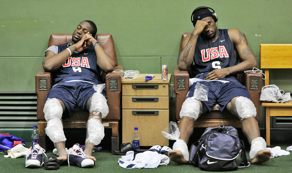 . USA Basketball team memeber Dwyane Wade, left, and LeBron James, right, relax after a team workout Saturday, Aug. 12, 2006, in Seoul,  South Korea.  Team USA is in Seoul to play exhibition games prior to play next week in Japan at the World Championships.  (AP Photo/David Longstreath)