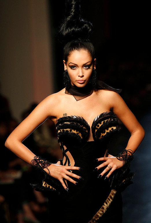 . French TV reality show star Nabilla wears a creation for Jean-Paul Gaultier\'s Haute Couture Fall-Winter 2013-2014 collection presented Wednesday, July 3, 2013 in Paris. (AP Photo/Jacques Brinon)