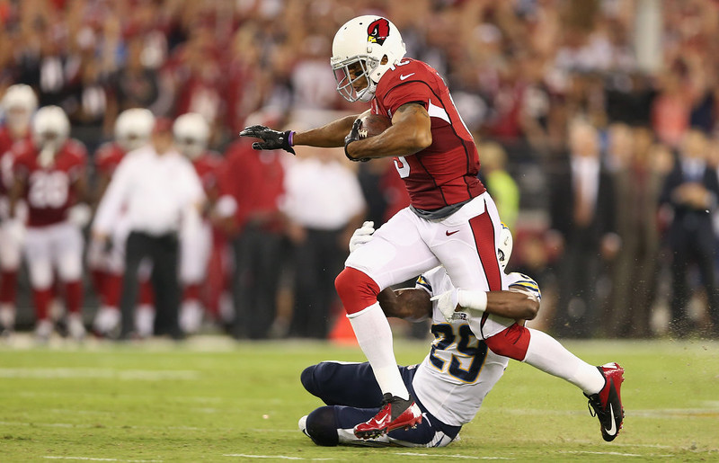 . Wide receiver Michael Floyd #15 of the Arizona Cardinals makes a 63 yard reception against cornerback Shareece Wright #29 of the San Diego Chargers in the first quarter of the NFL game at the University of Phoenix Stadium on September 8, 2014 in Glendale, Arizona.  (Photo by Christian Petersen/Getty Images)