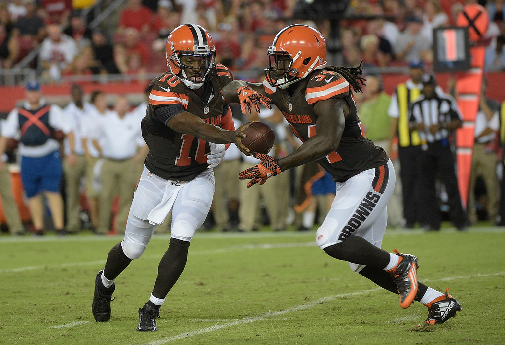 . Cleveland Browns quarterback Robert Griffin III (10) hands off to running back Isaiah Crowell (34) during the third quarter of an NFL preseason football game Friday, Aug. 26, 2016, in Tampa, Fla. (AP Photo/Phelan M. Ebenhack)