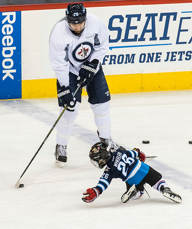 DAVID LIPNOWSKI / WINNIPEG FREE PRESS   Winnipeg Jets Captain #26 Blake Wheeler with his son Louie during practice at MTS Centre Sunday January 22, 2017.