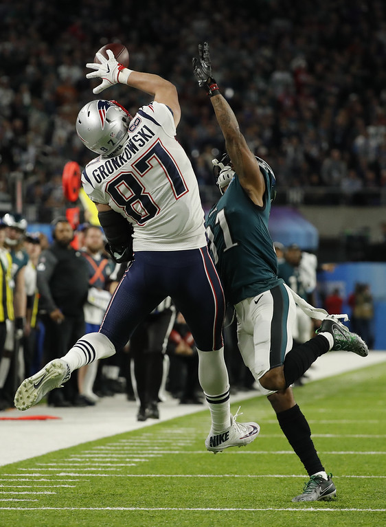 . Philadelphia Eagles cornerback Jalen Mills (31) breaks up a pass intended for New England Patriots tight end Rob Gronkowski (87), during the first half of the NFL Super Bowl 52 football game Sunday, Feb. 4, 2018, in Minneapolis. (AP Photo/Charlie Neibergall)