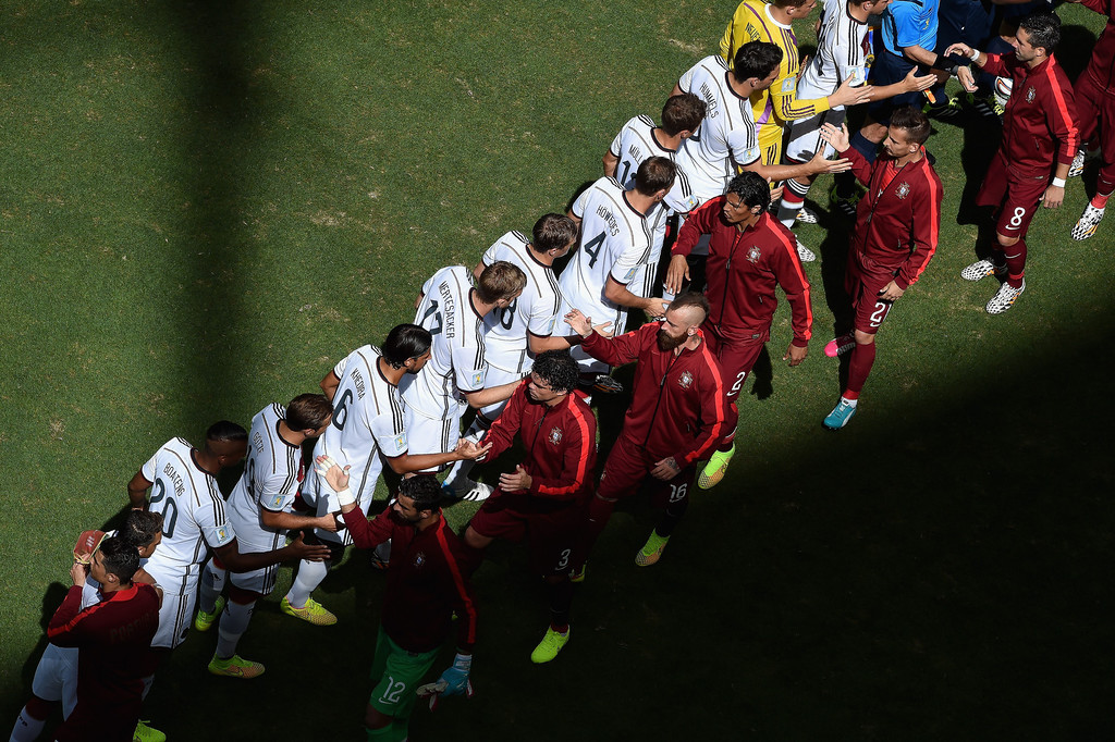 . Germany and Portugal players shake hands before the 2014 FIFA World Cup Brazil Group G match between Germany and Portugal at Arena Fonte Nova on June 16, 2014 in Salvador, Brazil.  (Photo by Francois Xavier Marit - Pool/Getty Images)