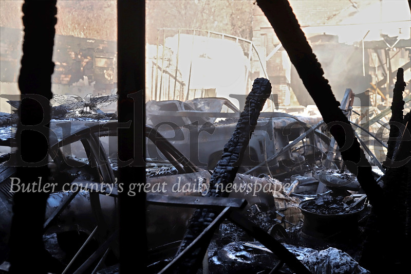 A 1974 Vega Pro Street (left), a 78 GMC High Sierra pickup truck, an 80s era Ford Mustang and Ford Thunderbird were among vehicles destroyed when smoldering ashes from Friday night's fire rekindled to spark a second blaze Saturday morning. Seb Foltz/Butler Eagle