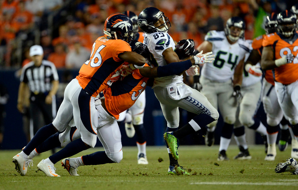 . Wide receiver Doug Baldwin (89) of the Seattle Seahawks makes a first down catch and gets taken down during the first half.  The Denver Broncos vs the Seattle Seahawks At Sports Authority Field at Mile High. (Photo by AAron Ontiveroz/The Denver Post)