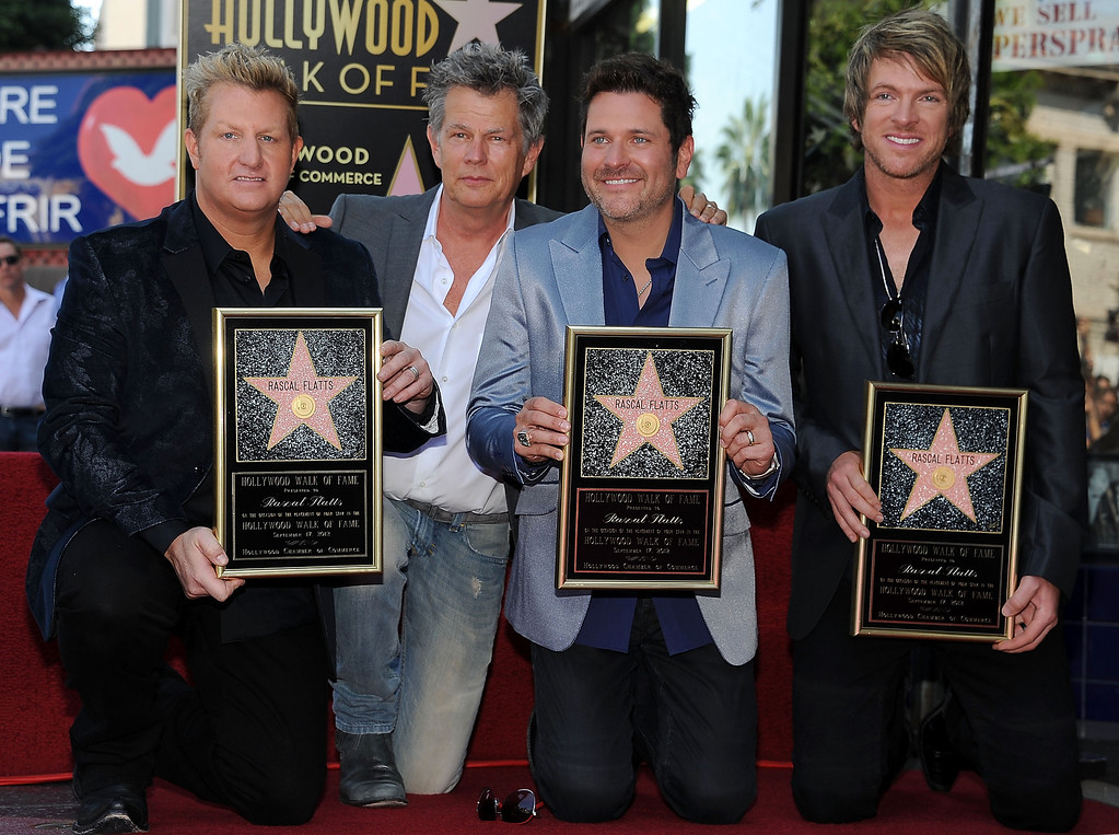 . HOLLYWOOD, CA - SEPTEMBER 17: (L-R) Gary LeVox, David Foster, Jay DeMarcus and Joe Don Rooney attend the ceremony honoring them with a Star on The Hollywood Walk of Fame on September 17, 2012 in Hollywood, California. (Photo by Valerie Macon/Getty Images)