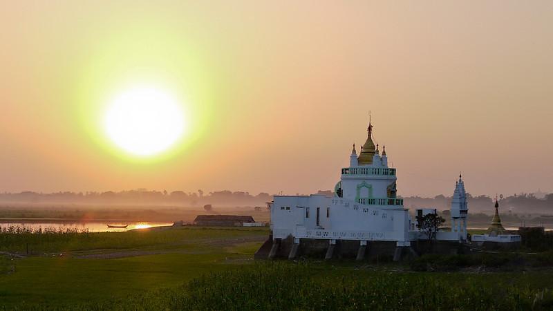 Sunset at U Bein Bridge, a gorgeous teak bridge near Mandalay.