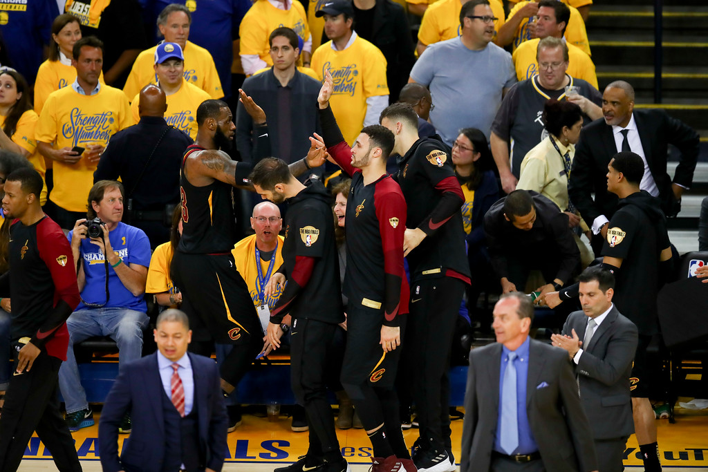 . Cleveland Cavaliers forward LeBron James, left, is congratulated by teammates during the second half of Game 1 of basketball\'s NBA Finals against the Golden State Warriors in Oakland, Calif., Thursday, May 31, 2018. (AP Photo/Ben Margot)