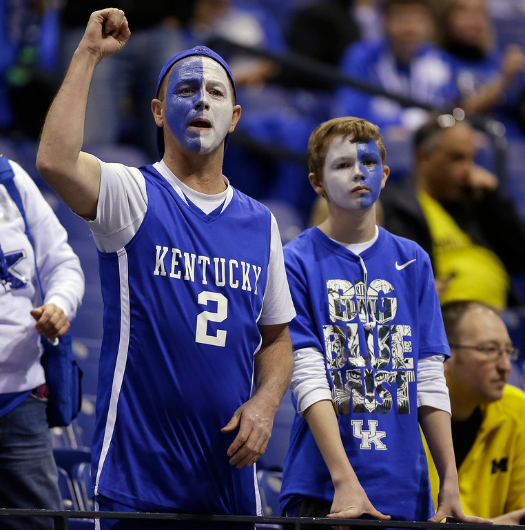 . Kentucky fan cheer before an NCAA Midwest Regional final college basketball tournament game against Michigan Sunday, March 30, 2014, in Indianapolis. (AP Photo/Michael Conroy)