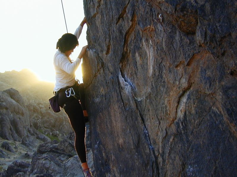 Bianca climbing in the sunset Room for Improvement, 5.10d Hueco Wall, New Jack City