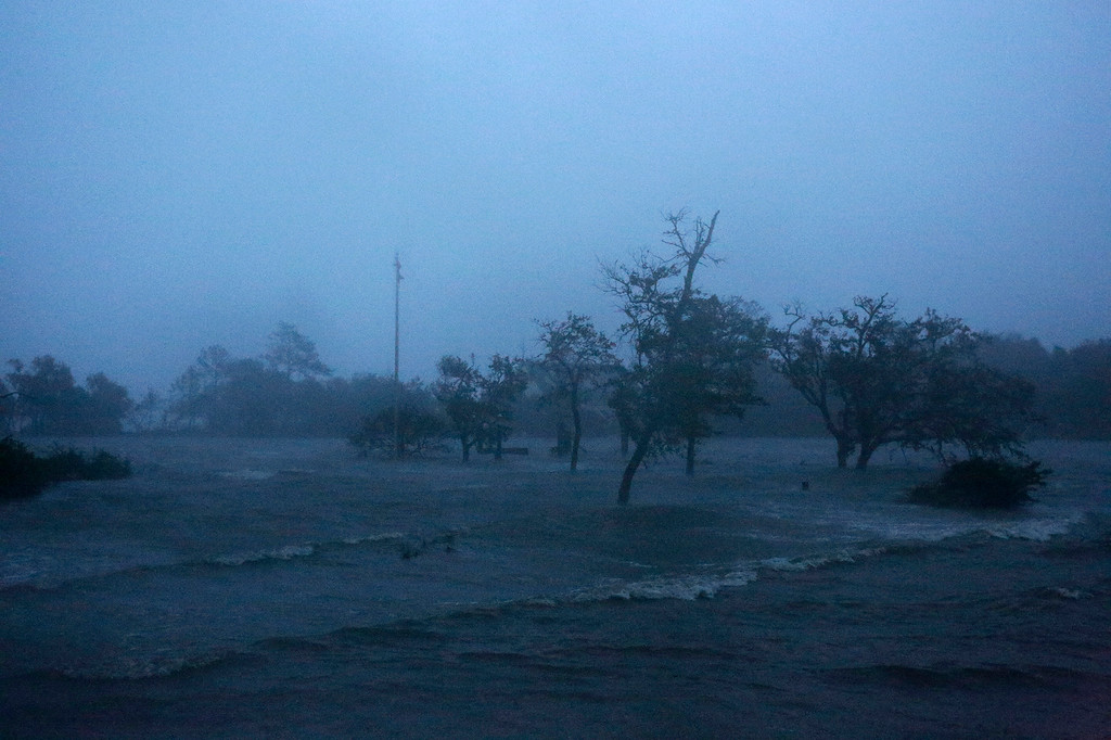 . Before sunrise, high winds and storm surge from Hurricane Florence hits Swansboro N.C.,Friday, Sept. 14, 2018. (AP Photo/Tom Copeland)