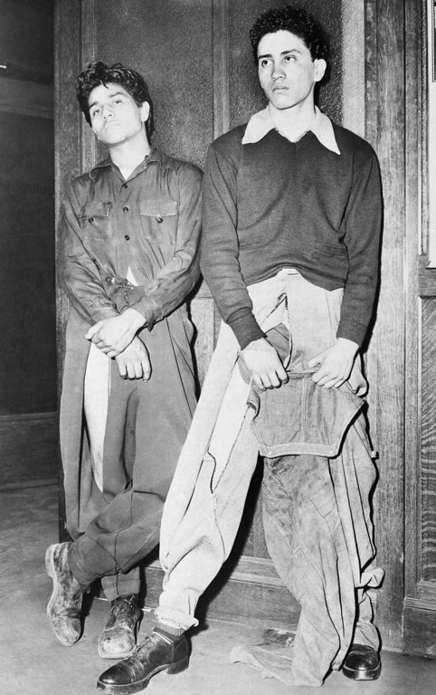". Noe Vasquez, left, 18, and Joe Vasquez, 18, unrelated to Noe, reported to Los Angeles, Calif., police they were seized by sailors who tore peg-topped trousers, although one youths wore overalls over them, June 12, 1943.  Police said the sailors may have been passing through the city since the area where the attack allegedly occurred was an ""out of bounds area for the Navy.\"" (AP Photo)"