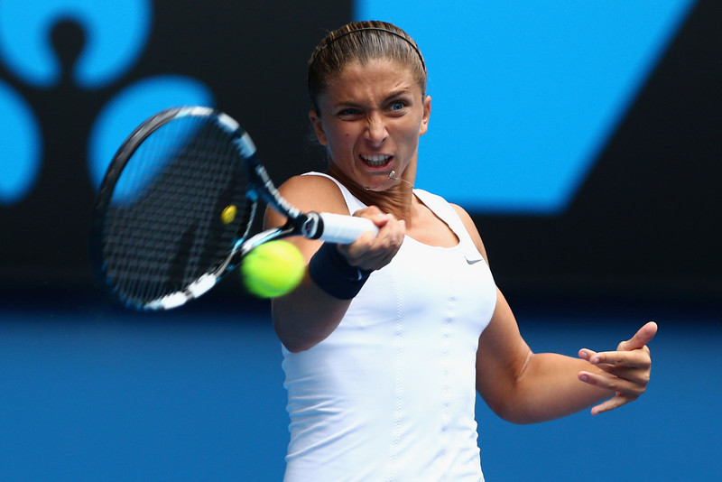 . Sara Errani of Italy plaus a forehand in her doubles final match with Roberta Vinci of Italy against Ashleigh Barty and Casey Dellacqua of Australia during day twelve of the 2013 Australian Open at Melbourne Park on January 25, 2013 in Melbourne, Australia.  (Photo by Mark Kolbe/Getty Images)