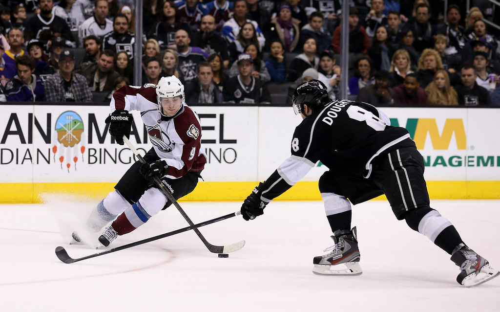 . LOS ANGELES, CA - DECEMBER 21:  Matt Duchene #9 of the Colorado Avalanche controls the puck against Drew Doughty #8 of the Los Angeles Kings at Staples Center on December 21, 2013 in Los Angeles, California.  The Kings won 3-2 on a shootout.  (Photo by Stephen Dunn/Getty Images)