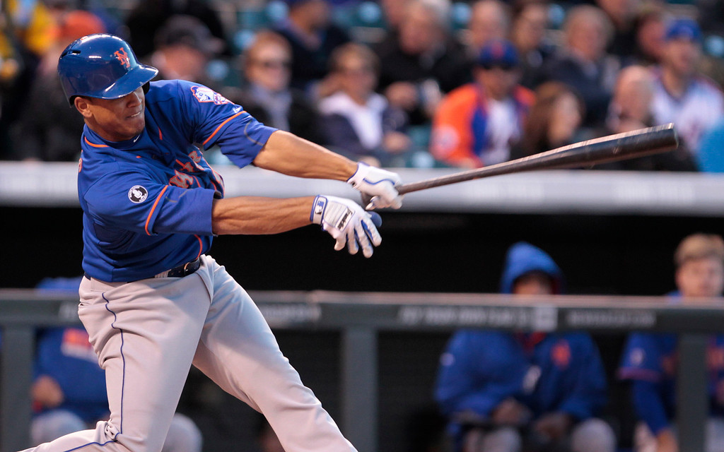 . New York Mets\' Juan Lagares swings at a pitch in the third inning of a baseball game against the Colorado Rockies in Denver, Thursday, May 1, 2014. (AP Photo/Joe Mahoney)