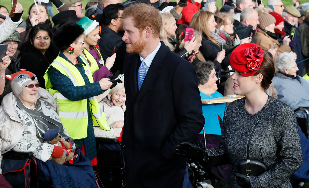 . Britain\'s Prince Harry and Princess Eugenie arrive to attend a Christmas day church service in Sandringham, England, Sunday, Dec. 25, 2016. A heavy cold is keeping Queen Elizabeth II from attending the traditional Christmas morning church service near her Sandringham estate. (AP Photo/Kirsty Wigglesworth)