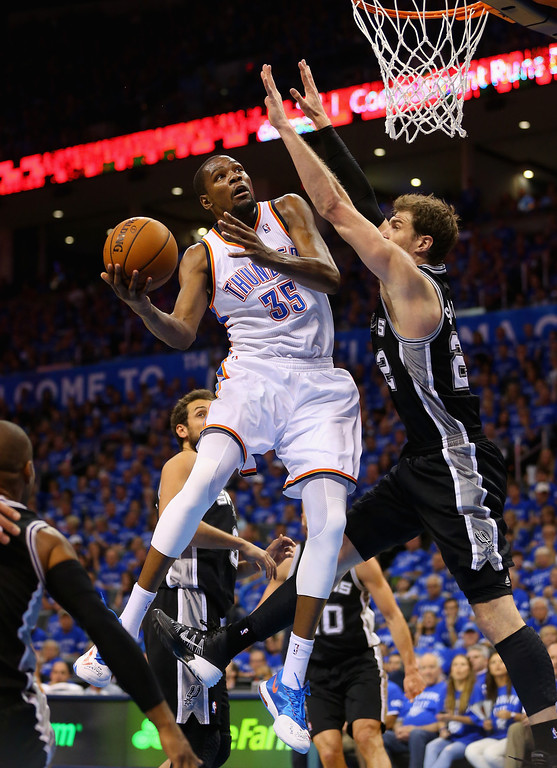 . Kevin Durant #35 of the Oklahoma City Thunder drives to the basket against Tiago Splitter #22 of the San Antonio Spurs in the third quarter during Game Three of the Western Conference Finals of the 2014 NBA Playoffs at Chesapeake Energy Arena on May 25, 2014 in Oklahoma City, Oklahoma.  (Photo by Ronald Martinez/Getty Images)